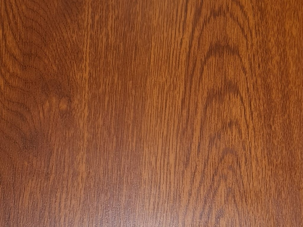 A colour sample of Golden Oak Laminate Material
