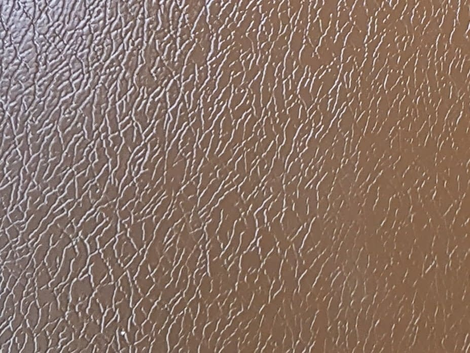 A colour sample of Vandyke Brown Plastisol Material