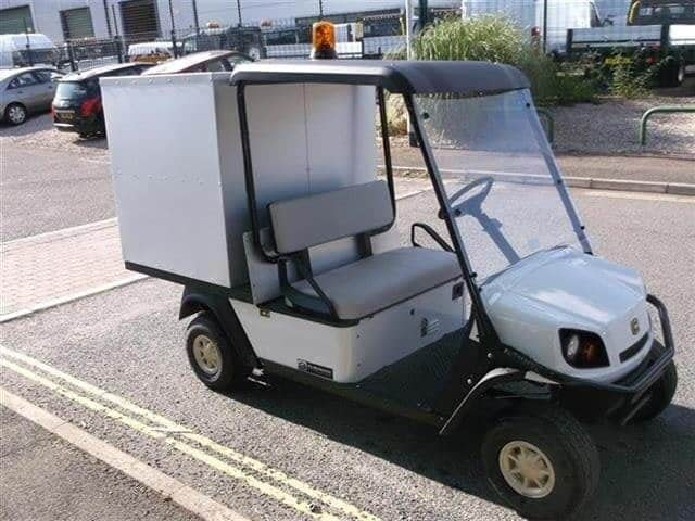 A Golf Buggie with a Bespoke Storage Box on the back